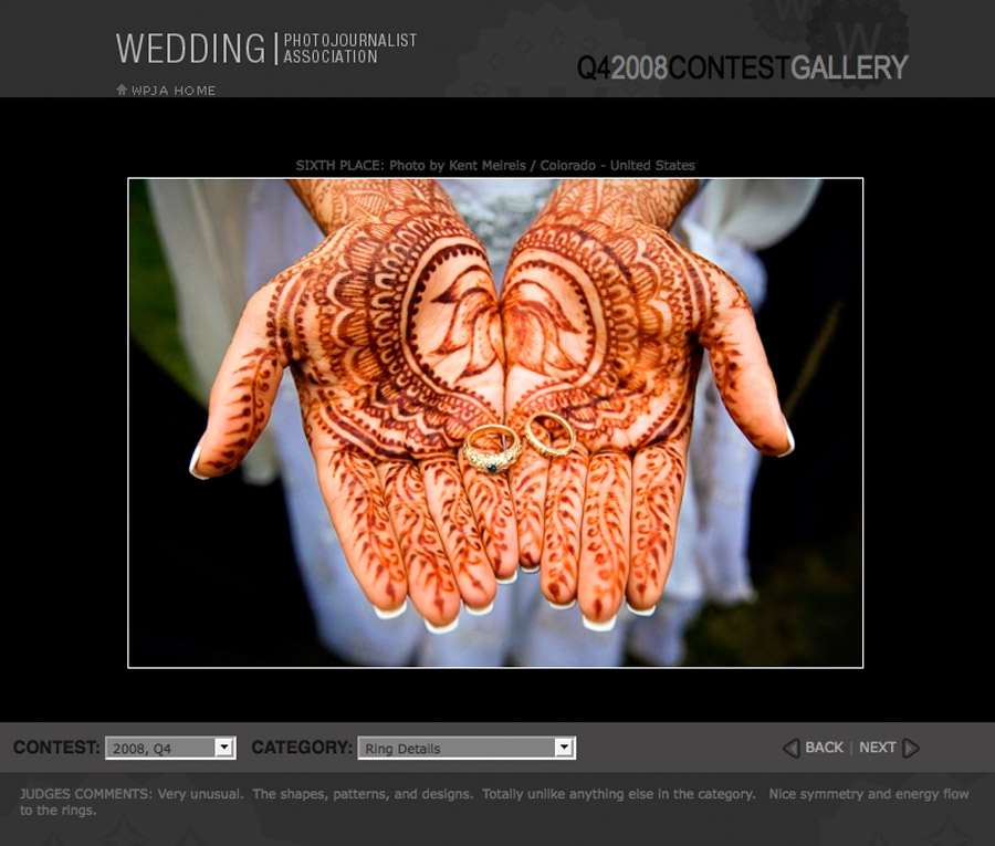 Tisha holds her wedding rings in her hands covered in henna.