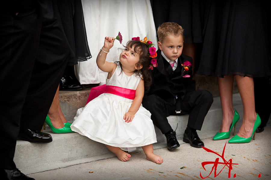 The flower girl and the ring bearer were in their own little world during the wedding party pictures.