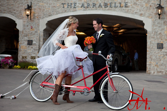 Getting on a bicycle in a wedding dress isn
