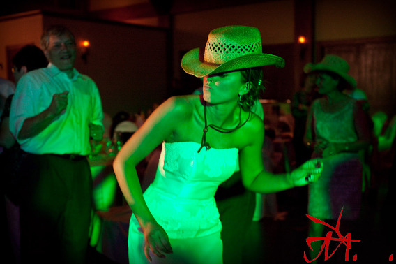 I love this picture of Jenna dancing with one of the many cowboy hats they passed around.