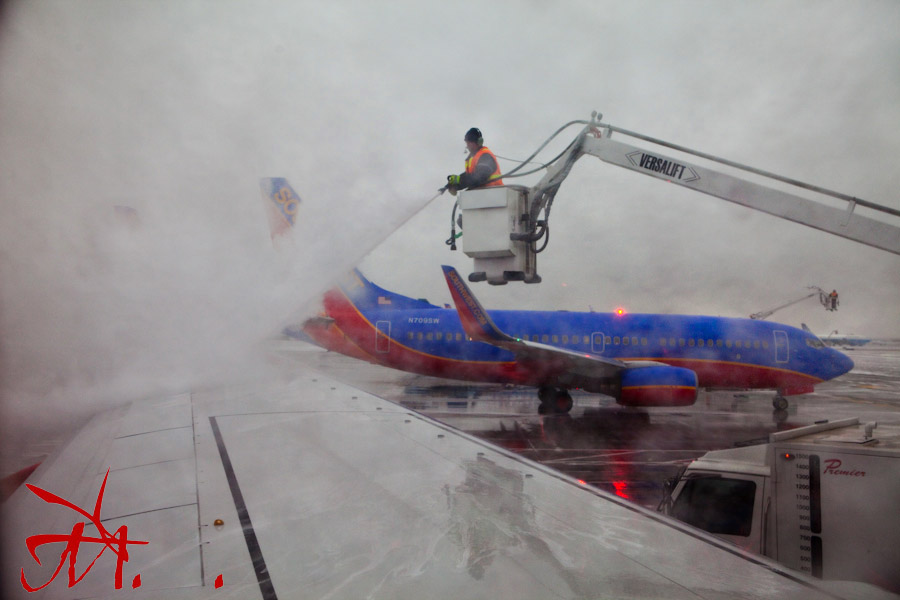 Deicing our plane at Denver international Airport.