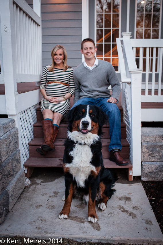 A couples pregnancy portrait at home with their dog