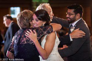 Highlands Ranch Mansion Wedding Reception Parents Toast Bride Groom Hug