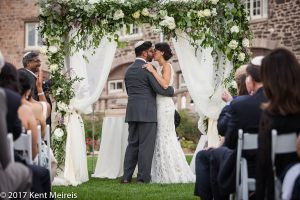 Highlands Ranch Mansion Wedding Ceremony Bride Groom Kiss Chuppah