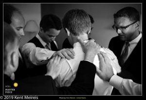 Award Winning Wedding Photojournalist Kalispell Montna Groom Groomsmen Prayer