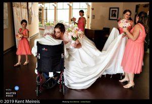 Award Winning Wedding Photojournalist Kalispell Montna Bride Kiss Wheelchair